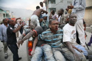 Haiti earthquake: '100,000-500,000 may be dead' 70% of structures collapsed in affected areas