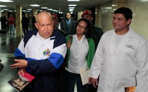 Venezuela's Hugo Chavez returns after Cuba cancer care