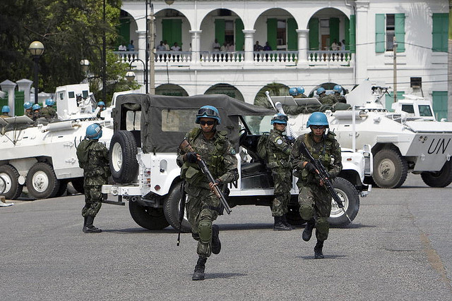 HUGE MINUSTAH PRESENCE IN CITE SOLEIR AND OTHER SLUM AREAS. ARMOURED PERSONNEL CARRIERS, TRUCKLOADS OF ARMED TROOPS AND DOZENS OF MINUSTAH SUVS AS ARISTIDE AGITATORS DO THEIR BEST TO DESTABILIZE THE SITUATION