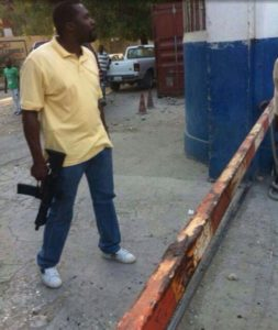IS ARNEL BELIZAIRE'S MACHINE GUN REGISTERED WITH THE PNH??  ARNEL BELIZAIRE ATTACKS ONA AS HE WORKS TO GUARANTEE NO ELECTIONS IN 2014 –   WHO IS PAYING HIM??