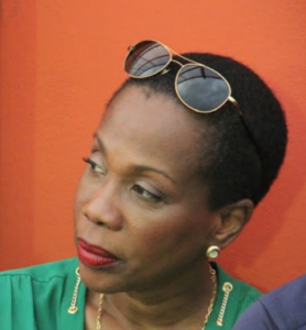 GEORGE RACINE – UPSET AS WIFE MAGALI FIRED AS MINISTER OF SPORTS, PLANS MASSIVE MANIFESTATION AGAINST PRIME MINISTER LAMOTHE