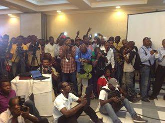 LAURENT LAMOTHE HOLDS PRESS CONFERENCEWITH STANDING-ROOM ONLY CROWD