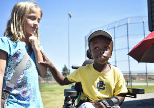 Wheelchair-using 8-year-old adopted from Haiti is Little League team's No. 1 fan