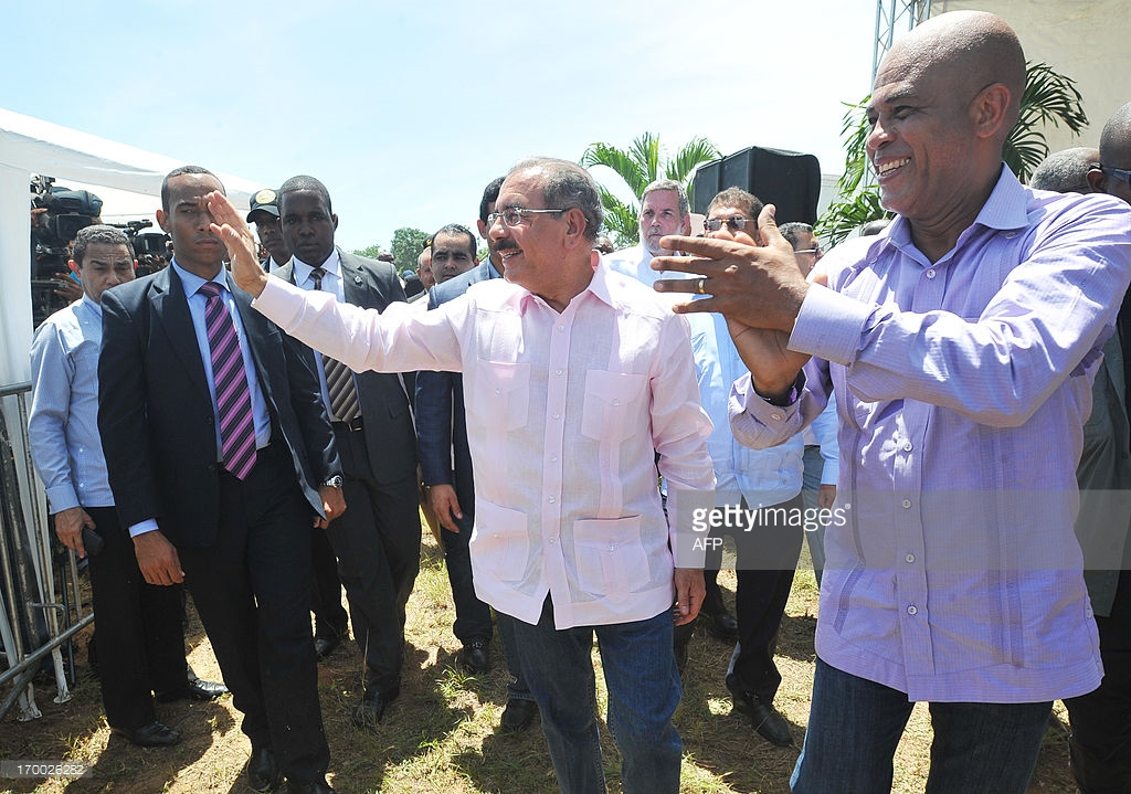 Dominican President Danilo Medina (L) meets with Haitian President Michel Martelly as they inaugurate a reforestation program in Ouanaminthe, Haiti, on the occasion of the World Environment Day on June 5, 2013.