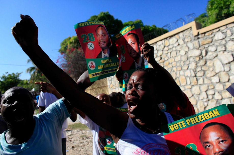 In Haiti, tire barricades burn as candidate alleges fraud- Added COMMENTARY By Haitian-Truth