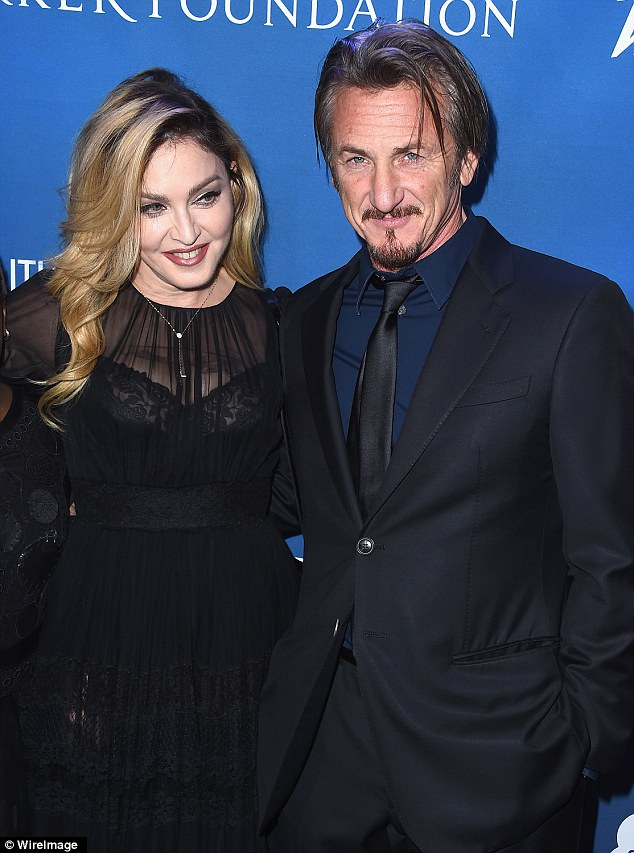Madonna serenades crowd at Haiti fundraiser reigniting Sean Penn romance rumours…as actor is investigated over interview with El Chapo