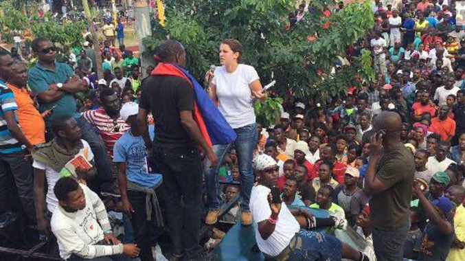 Local woman faces protest leaders amid recent Haitian riots