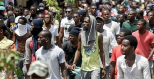MORE CAREFULLY CRAFTED LAVALAS PROPAGANDA: Haiti's Police Clash With Protestors Over Budget Bill- Added COMMENTARY By Haitian-Truth