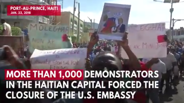 Photos: Anti-Trump Protest Forces U.S. Embassy Lockdown in Haiti After President's Alleged 'Shithole Country' Remarks